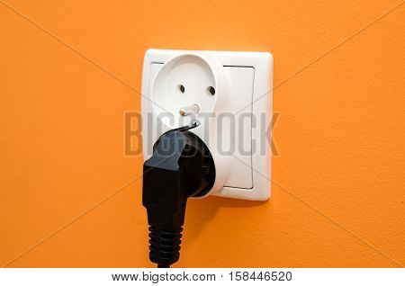 Electrical socket in wall. Electrical bill utilities cost increase rise socket wall composition