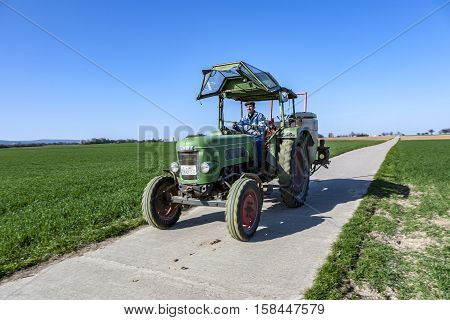 Farmer On His Tractor Rides Back After Plowing His Field