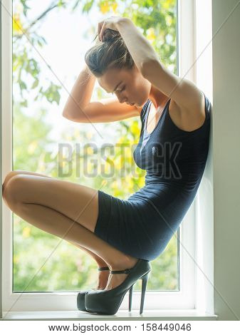 Pretty Girl On Window Sill
