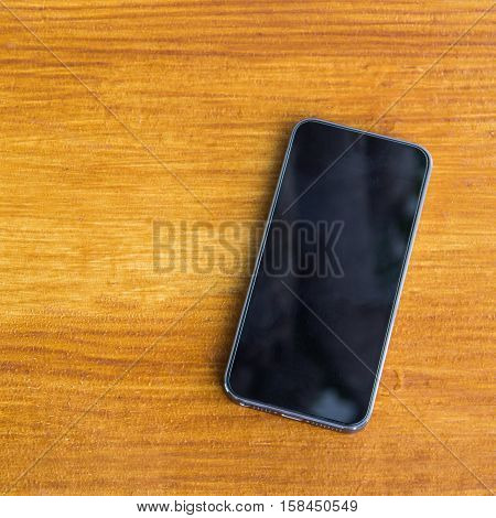 Mobile smart phone on wood table background