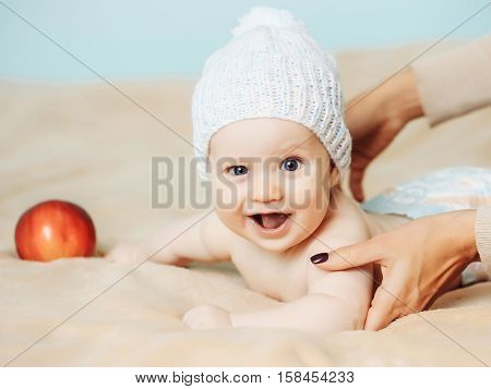 Baby Boy In White Hat And With Red Apple