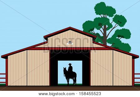 Cowboy astride his horse in the shadow of a barn