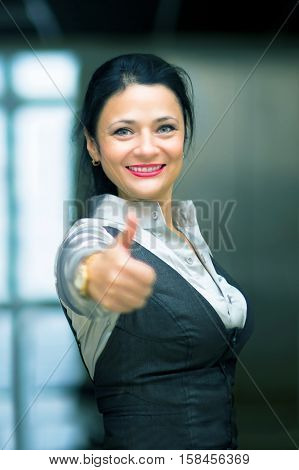 photo happy successful business woman in office