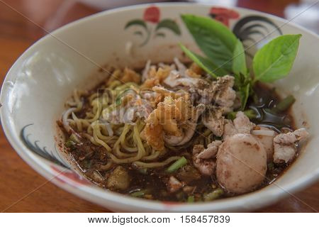 closeup Thai noodles with boiled in a bowl. ( Moo nam tok) at restaurant.