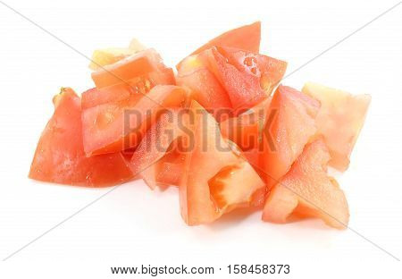 Red Organic Heirloom Tomato Chunks In Pile