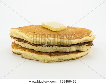 Pancakes in Stack with Pat of Butter on White