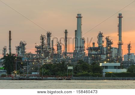 Petroleum factory with sunrise sky background, industrial background