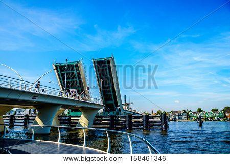 Modern Draw Bridge being opened at Zaandijk over the Zaan River in the Netherlands