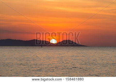 Sunset over the seacoast behind the mountain, natural landscape background