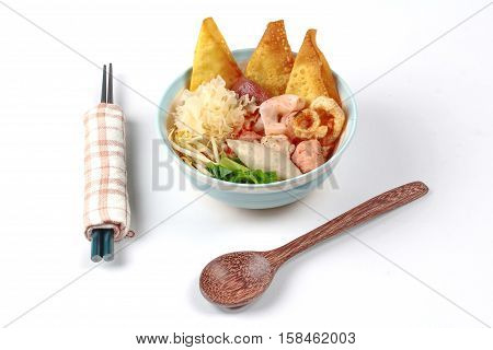 Thai noodle with pink tofu soup topped rugby fishball ,wonton, porkball ,boiled porkblood ,pork rind ,coriander and white mushroom call Yen Ta Fo in Thai poster