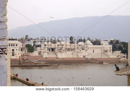 PUSHKAR, INDIA - FEBRUARY 18: Pushkar lake or Pushkar Sarovar at Pushkar, Rajasthan, India, Holy Hindu City, on February 18, 2016.
