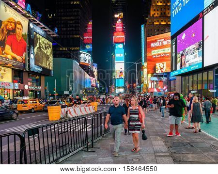 NEW YORK,USA - AUGUST 21,2016 : Night scene at Times Square with lots of people and neon lights