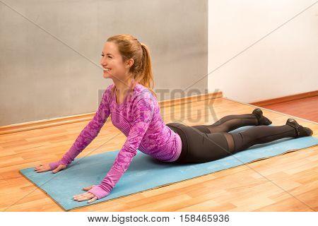 Girl practicing yoga Yoga-Bhujangasana / Cobra Pose