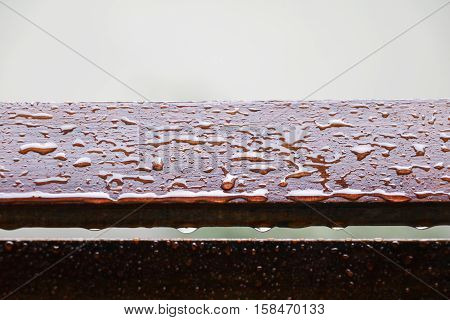 Drop of water on wood with raindrop after a rain with copy space.
