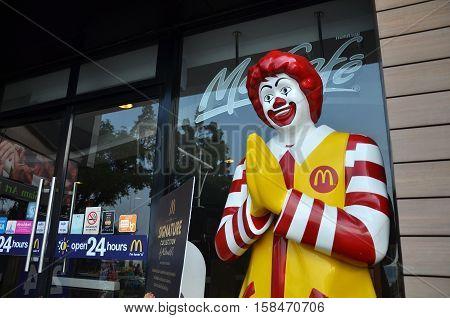 Ronald Mcdonald Character Near Entryway To Mcdonals Restaurant