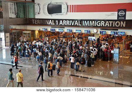 SINGAPORE - 18 NOV 2016: Travelers enter immigration control at Changi International Airport in Singapore.