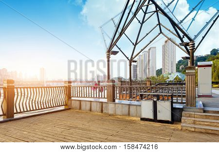 The Yangtze River skyline next to the city wooden floors and fence Chongqing China.