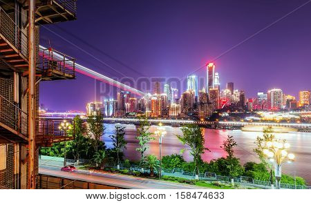 Night view of the city in the Yangtze River the cable trail across the river Chongqing China.