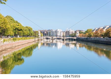 The Urumea river is passing through the Basque city of Donostia San Sebastian. View ahead to the Maria Cristina bridge and the district Gros. The Basque river is flowing into the Bay of Biscay