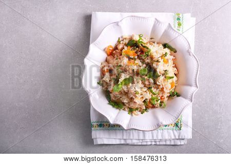 Coconut chicken breast with rice in a bowl top view