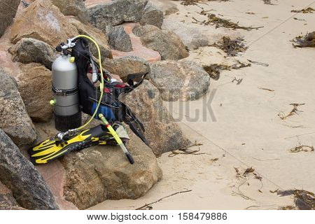 Scuba Diving equipment with flippers on sand beach