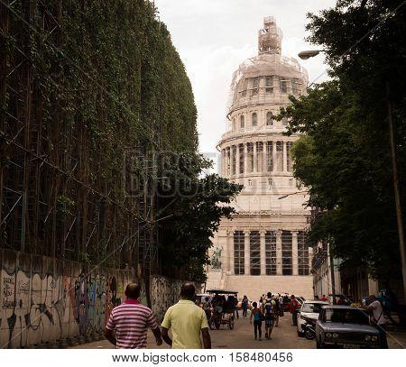 Havana, Cuba on December 23, 2015: Cuban people walking towards capitolio goverment building