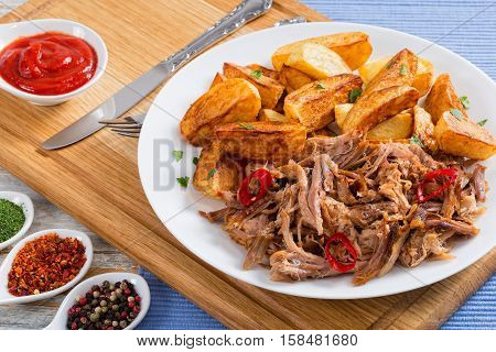 Pork Shoulder Grilled In Oven With Fried Potato Wedges