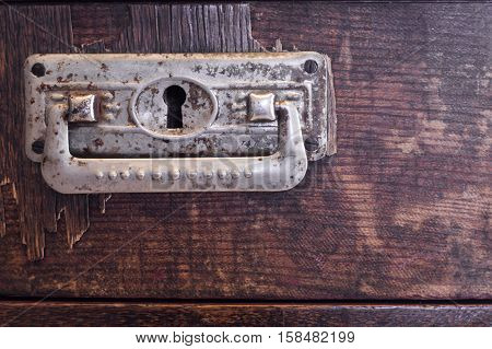 Old wooden drawer with ornate pewter handles, texture , background