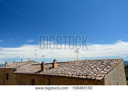 San Gimignano Italy - September 6 2016: Vintage roofs in San Gimignano city in Tuscany Italy.