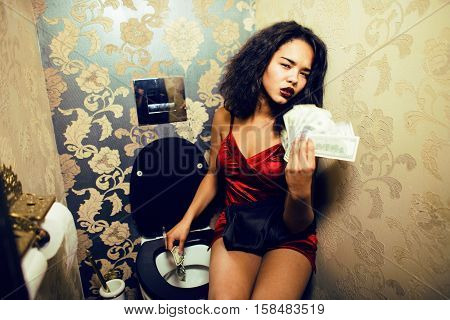 pretty young african american woman in luxury restroom with money, like prostitute, dirty cash concept