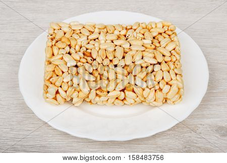 Brick Of Puffed Rice In Glass Plate On Table