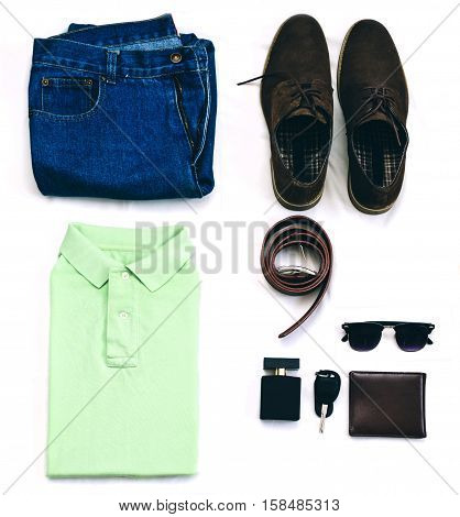 Outfit of clothes young man with vintage blue jeans, green polo shirt, brown suede shoes, clubmaster sunglasses, purse and other on the white background