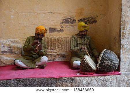 JODHPUR, RAJASTHAN, INDIA - FEBRUARY 10, 2016 - Unidentified indian men playing traditional instruments inside Mehrangarh fort
