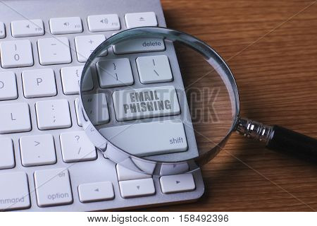 Computer keyboard with EMAIL PHISHING on button