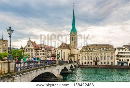 ZURICH,SWITZERLAND - SEPTEMBER 3,2016 - View at the Fraumunster church with Munster bridge over Limmat river in Zurich. Zurich is the largest city in Switzerland.