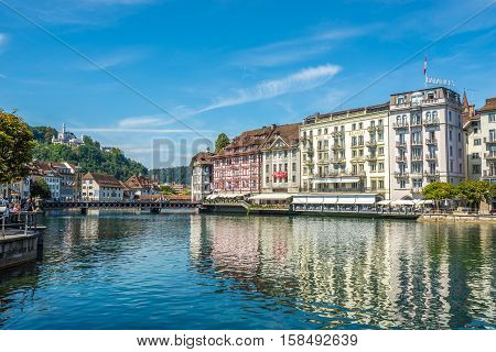 LUZERN,SWITZERLAND - SEPTEMBER 3,2016 - Bank of the river Reuss in Luzern. Luzern is a city in central Switzerland.