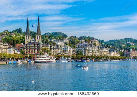 LUZERN,SWITZERLAND - SEPTEMBER 3,2016 - River Reuss with church of Saint Leodegar in Luzern. Luzern is a city in central Switzerland.