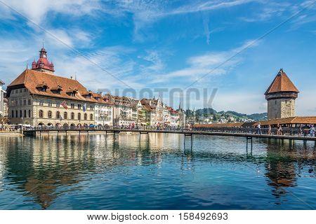 LUZERN,SWITZERLAND - SEPTEMBER 3,2016 - Chapel bridge with City hall in Luzern. Luzern is a city in central Switzerland.