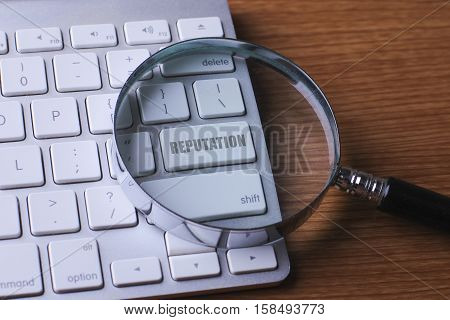Computer keyboard with REPUTATION word button .