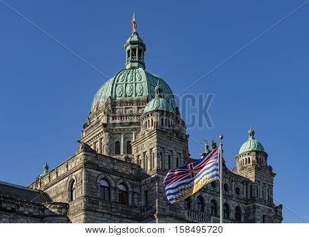 British Columbia Parliament Building BC Flag Victoria BC Canada on a against a blue sky