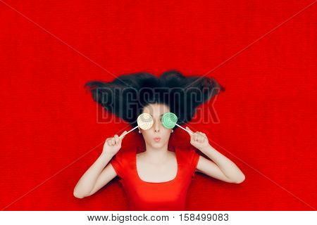 Surprised Weird, Christmas Girl Holding Lollipops on red Background