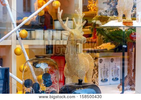 Christmas reindeer, dog and toys at a Christmas souvenir market shop, decorated and illuminated in Bruges, Belgium