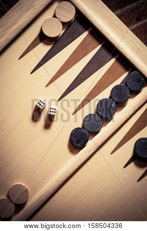 Backgammon board with double six dice shot from above.