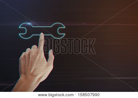Human Hand Pressing Wrench Icon on Light Motion Background and Lens Flare - Digital 3d Effect Style Color