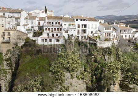 RONDA, SPAIN - MARCH 1, 2014: White houses over the gorge in Ronda Andalusia Spain