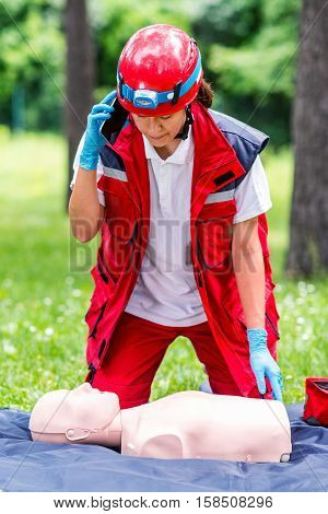 CPR training outdoors, toned image, one woman only