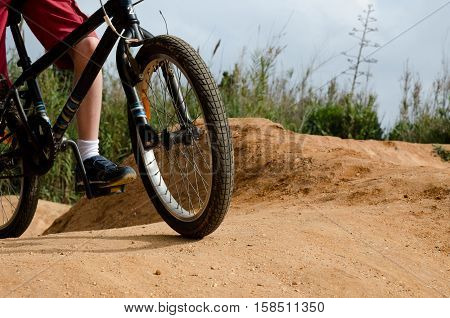 Front of bmx bike on dirt track
