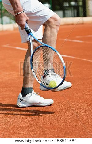 Taking Ball With Racquet From Tennis Court