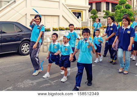 Bangkok, Thailand - January 8, 2016: Pupils of the Elementary School of Wat Chana Songkhram during festive procession through the streets of the city.