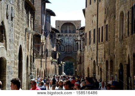 San Gimignano Italy - September 6 2016: Street in San Gimignano city in Tuscany Italy. Unidentified people visible.